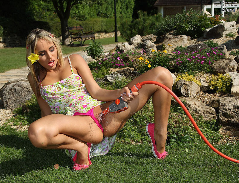 Sissy With The Garden Hose In The Back Yard
